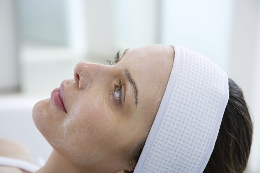 Woman laying down getting a chemical peel facial.